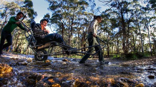 Bush wheeling: Parks Victoria provides the power source (Amy Anderson and David Petty) and Dave Stratton helps navigate ...