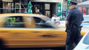 Heavily armed police patrol the streets of New York.