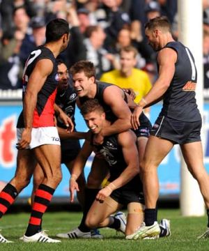 Marc Murphy and his Carlton teammates celebrate a goal. Murphy was best afield with 37 disposals and a goal.