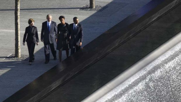 Laura and George Bush accompany their successors, Michelle and Barack Obama, next to the reflective pools at the World ...