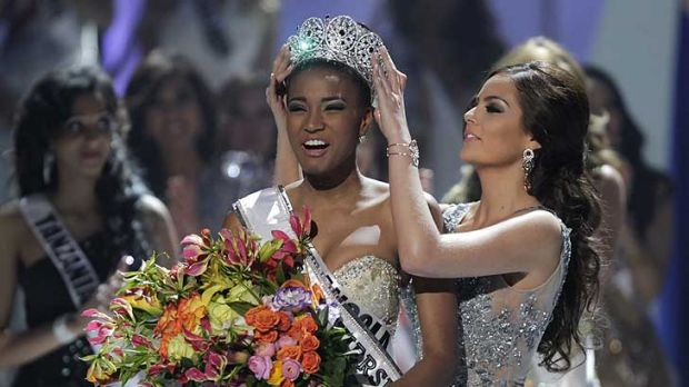 Miss Angola Leila Lopes, left, is crowned Miss Universe 2011 by Miss Universe 2010 Ximena Navarrete, of Mexico, in Sao Paulo.