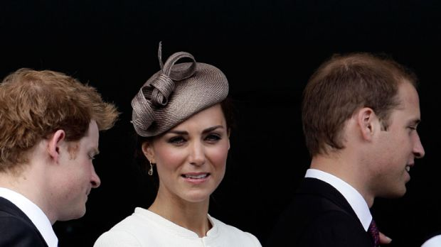 Catherine, Duchess of Cambridge, with her husband Prince William (right) and brother-in-law Prince Harry at the Epsom ...