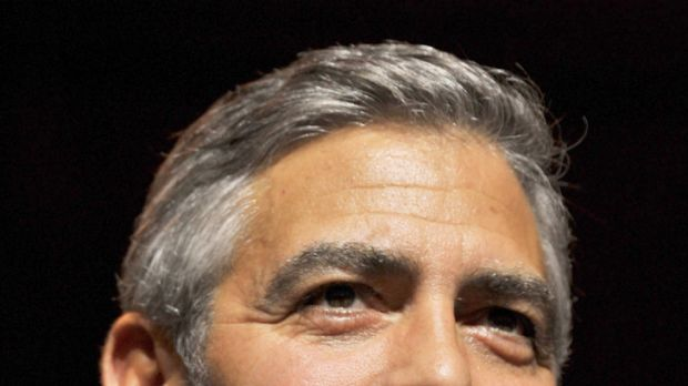 Sore point ... George Clooney mocks reporter for love life question.