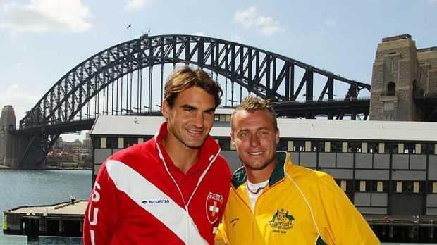Top shots: Roger Federer (left) and Lleyton Hewitt meet at yesterday's draw for their Davis Cup tie starting in Sydney today.