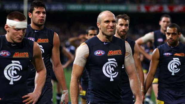 So close: Carlton skipper Chris Judd leads the vanquished Blues from the field after their 3-point loss to West Coast in ...