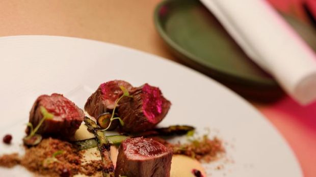 Wallaby fillet with white asparagus cream, charred green asparagus, wattleseed soil and wild blueberries at Sarti, in ...
