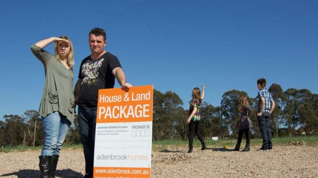 'It was the affordability that made us buy in Jordan Springs' ... Adam and Lisa Mercer with their children on their land ...