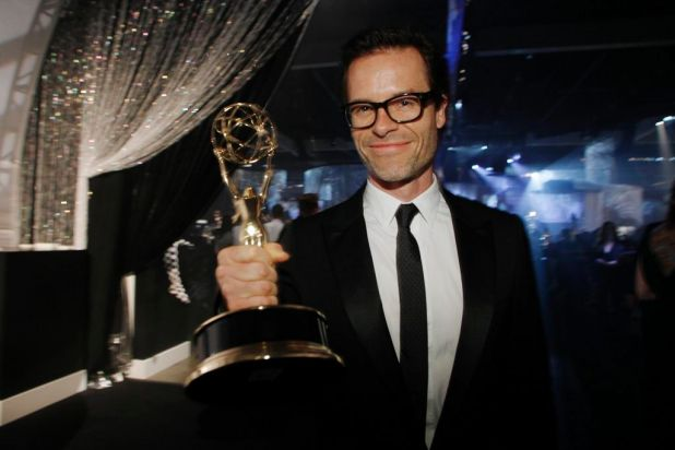 "Australian actor Guy Pearce holds his Emmy award for best supporting actor in a miniseries or a movie for ""Mildred Pierce."""