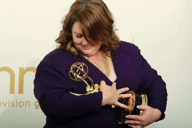 Actress Melissa McCarthy poses backstage with her Emmy award after winning for outstanding lead actress in a comedy ...