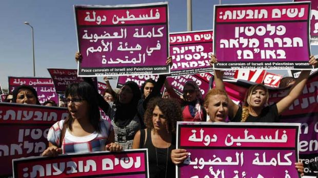 Palestinians, Israelis and foreign women activists attend a rally to show solidarity for a Palestinian state with full ...