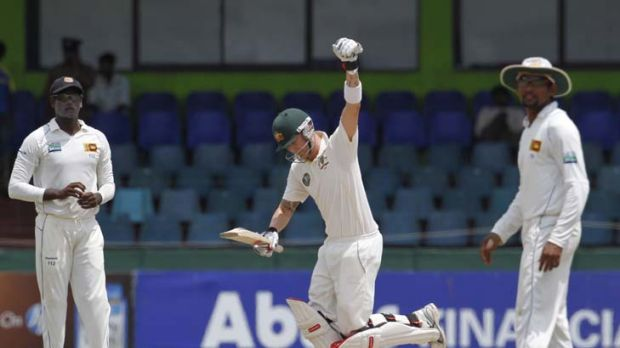 At last: Captain Michael Clarke celebrates his 15th Test hundred yesterday on the way to preserving a series win in Colombo.