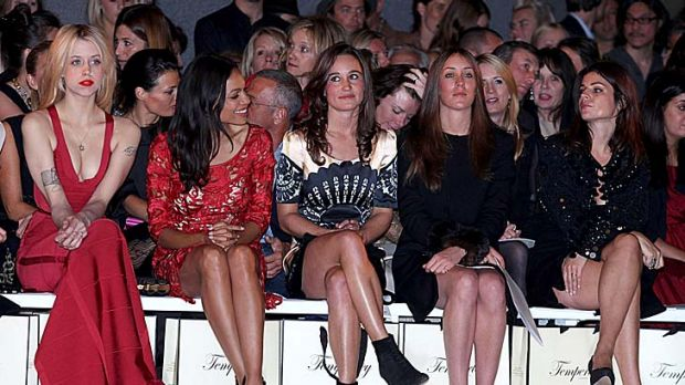 Out and about ... Pippa Middleton snapped in the front row at London Fashion Week. The length of her skirt caused a ...