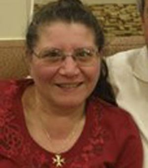 Maria Lourdes (Lou) Devrell was found in a pool of blood in the dining room.