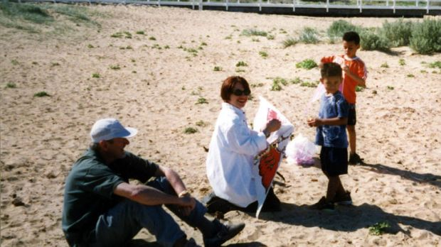 Colin Howard (left) and Sophie Mirabella and the then-secret couple with Mr Howard's grandchildren at Queenscliff in 2001.