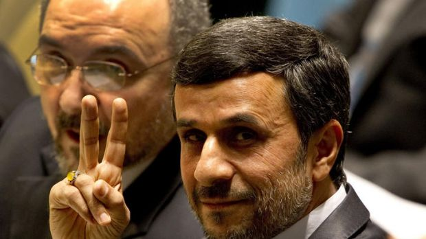 Mahmoud Ahmadinejad, President of Iran, flashes a peace sign from the floor of the General Debate of the 66th General ...