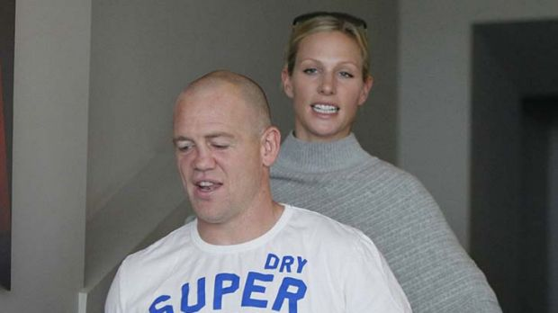 Toss scandal ... England captain Mike Tindall and wife Zara Phillips at the Rugby World Cup in New Zealand last year.