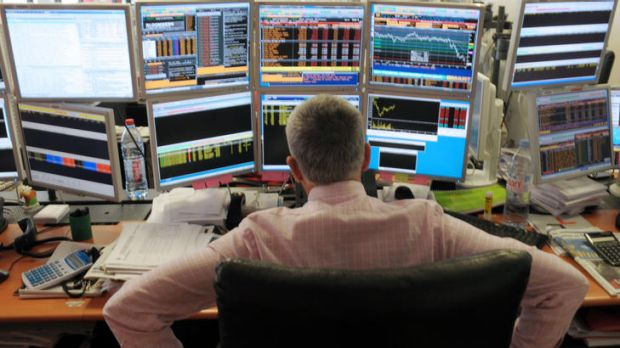 (FILES) - A picture taken on September 12, 2011 shows a broker watching screens in an office of the French investment ...