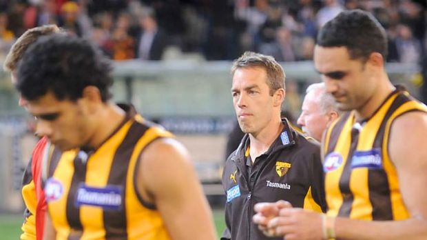 A grim Alastair Clarkson walks off with the players after the gut-wrenching defeat.