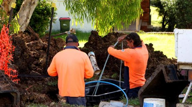 Building the national broadband network will require less than half as many workers as originally forecast.