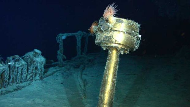 Images released by Odyssey Marine Exploration show, top, a stern compass, a water closet and a staircase of the wreck of ...
