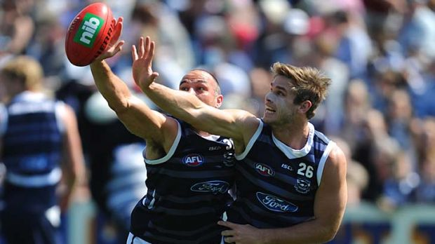 James Podsiadly and Tom Hawkins compete at Geelong training on Tuesday.