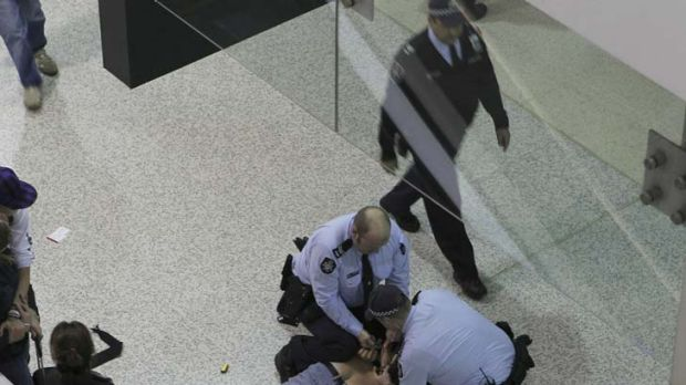 Federal Police pounce on a disgruntled passenger at Tullamarine airport last night after weather chaos caused the ...