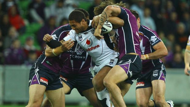 Committed ... Manu Vatuvei of the Warriors is tackled during the NRL second preliminary final match between the Storm ...