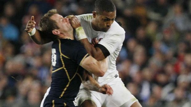 Controversial hit ... Delon Armitage tackles Chris Paterson in Auckland during the World Cup.