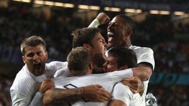 'Tournament rugby' ... England celebrate their dramatic win over Scotland.