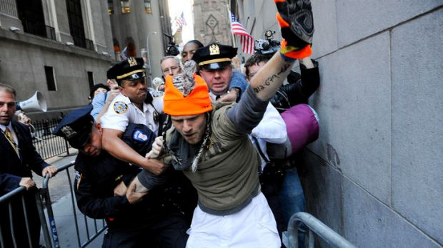 Police make an arrest on Wall Street during the Occupy Wall Street protest in New York.