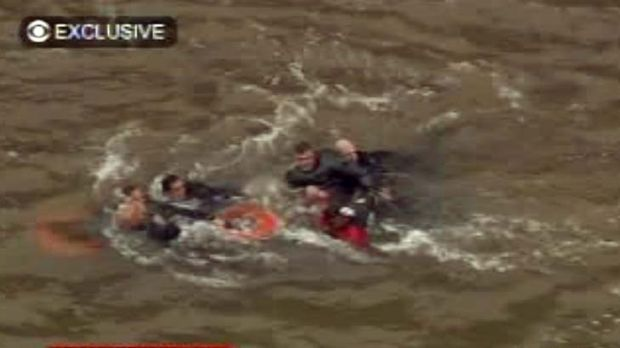In this frame grab image taken from WCBS-TV, survivors are pulled ashore by rescue workers.