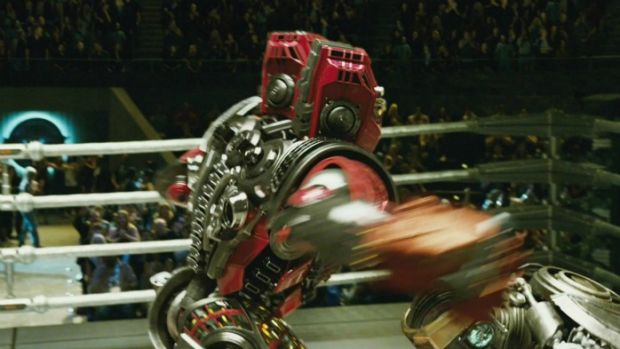 Duck & cover: one robot takes a swing at another robot in the robot boxing movie <i>Real Steel</i>. The film also ...
