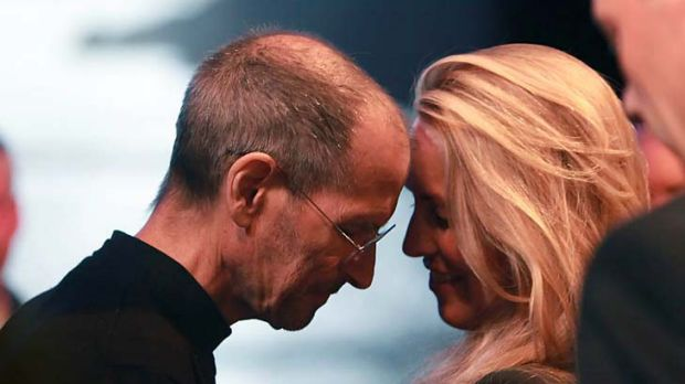 Steve Jobs leans his forehead against his wife, Laurene Powell Jobs, after delivering the keynote address to the Apple ...