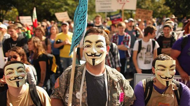 Veterans don Guy Fawkes masks while demonstrating in front of the US Chamber of Commerce in Washington, DC.