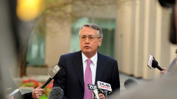 Downplaying expectations ... Wayne Swan speaks before the two-day tax forum, setting out its parameters and ruling out a ...