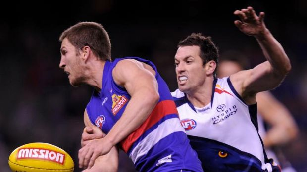 Old-school: Western Bulldogs captain - and 2011 best and fairest - Matthew Boyd (left) playing against Adelaide this ...