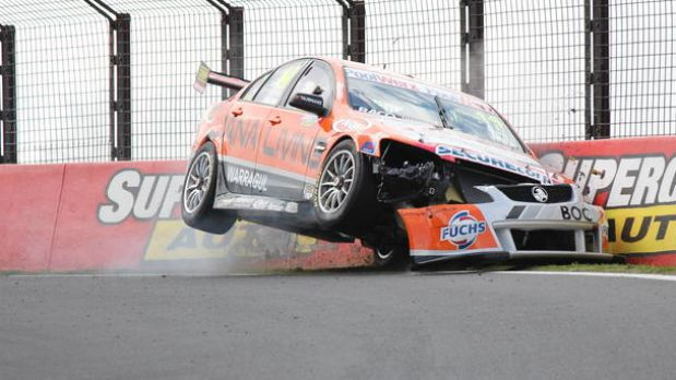 Bumper: Jason Bargwanna of Jana Living Racing drives his Holden into the wall during qualifying on Mount Panorama.