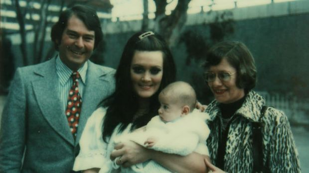 Moment of truth ... Christine Elliot with Adam in his christening gown in 1974 and, on that day, with his godparents, ...