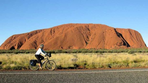 Frederike Moodie rides in central Australia, with Uluru a familiar backdrop.