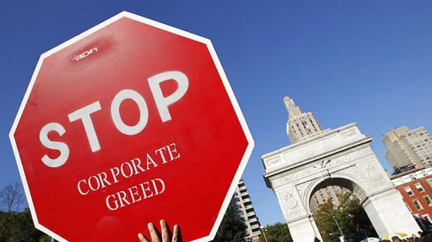 "Taking it to the streets ... a protester holds a sign during an ""Occupy Wall Street"" rally in New York's Washington ..."