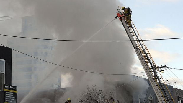 Brutal dealings ... Fire crews put out the Top on Tope brothel fire.