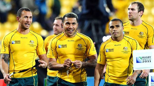 Snatching victory from the jaws of defeat ... Wallabies Quade Cooper, Digby Ioane and Will Genia celebrate after their ...