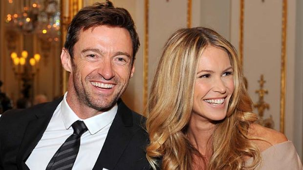 Happy occasion ... Hugh Jackman and Elle Macpherson wait to meet Queen Elizabeth II.