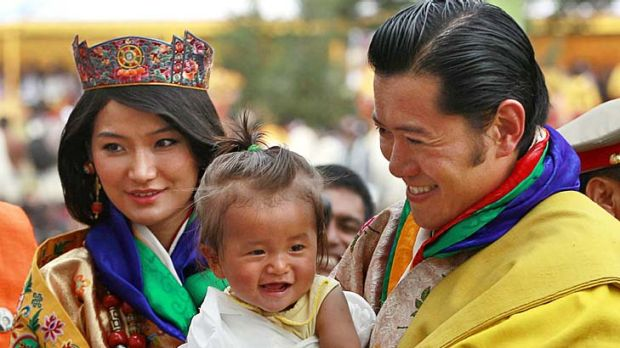 Just married ...King Jigme Khesar Namgyel Wangchuck, right, holds a young child as he greets locals with his new Queen.