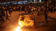 Egyptian Christians clash with soldiers and riot police during a protest against an attack on a church in southern ...