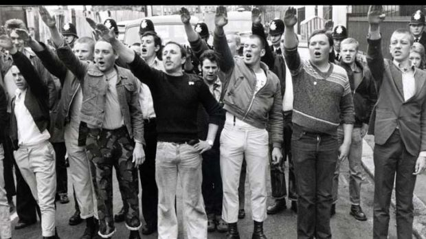 Pro-National Front marchers give the Nazi salute as they interrupt an anti-fascist rally in London's East End in April 1979.