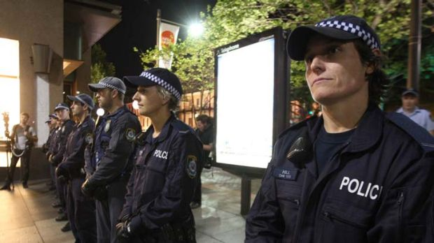 Police stand at the ready as Occupy Sydney protesters camp in Martin Place last night.