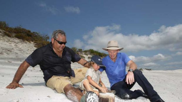 Opposition Leader Tony Abbott visits Gudi, an ancient camping site near Hope Vale, with Noel Pearson and his son, Charlie.