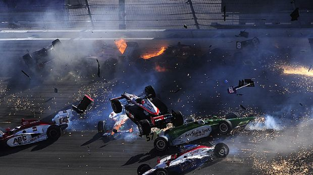 Australian driver Will Power's Honda goes airborne as part of a massive 15-car pile-up in Las Vegas.