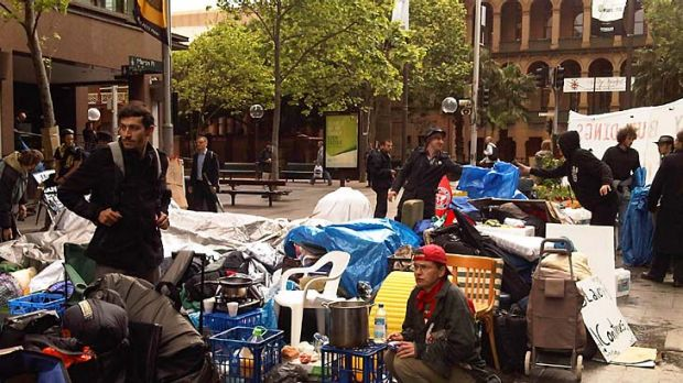 Standing their ground ... protesters at Martin Place this morning.